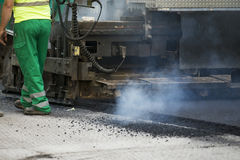 Tracked paver at asphalt pavement works Royalty Free Stock Image