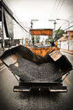 Tracked paver at asphalt pavement Stock Photos