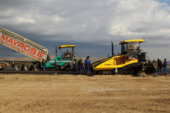 Tracked paver laying fresh asphalt pavement on a runway as part of the Danube Delta international airport expansion plan Royalty Free Stock Photos
