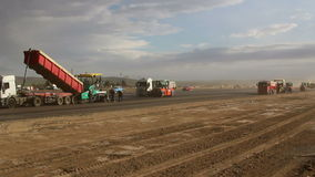Tracked paver laying fresh asphalt pavement,time lapse stock footage