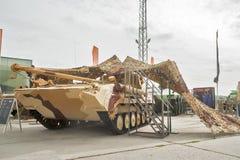 Tracked repair vehicle RMG under camouflage net Stock Photo