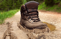 Tracking boot in a dirt Royalty Free Stock Image