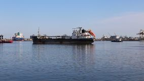 Commercial barge coming out of port stock video