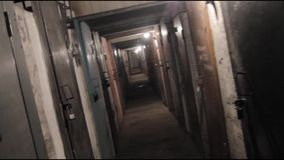 Tracking in on the corridor of an old building,long and dark hallway.