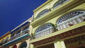 Looking Up at Balconies in Havana Cuba Old Town Square stock video footage