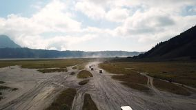 Tracking by drone on driving 4X4 experience. 4K Tracking by drone on driving experience to Mt.Bromo, Pasuruan, East Java, Indonesia. Adventure driving Off-road stock footage