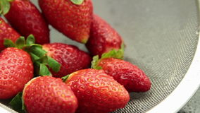 Tracking fresh tasty strawberry pack. Collection of dolly clips of red fresh wet strawberry fruit on black reflective surface with water stock video footage