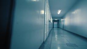 Tracking inside a long dark gloomy corridor.