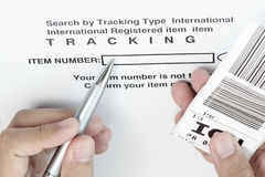Tracking the item. With barcode and pen Royalty Free Stock Photos