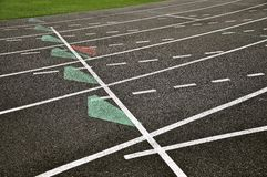 Tracking lanes with markings. Sport field with tracking lanes and markings that can work as a background Royalty Free Stock Photo