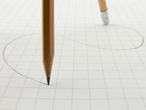 Tracking pencils. One pencil draws a line, another pencil erases Stock Photos