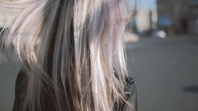 Woman walking street hair blowing wind sunglasses stock footage