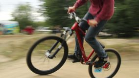 Tracking shot of BMX bicycle in competition racing to win. Stock footage stock footage