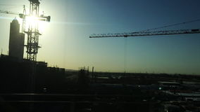 Tracking shot of cranes at construction site, Dubai, United Arab Emirates stock video
