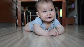 Tracking shot, Cute six months old baby boy got tired of tummy timme starting to cry.  stock video