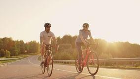 Tracking shot of a group of cyclists on country road. Fully released for commercial use.  stock footage
