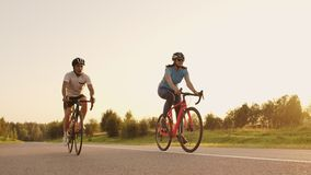 Tracking shot of a group of cyclists on country road. Fully released for commercial use.  stock video footage
