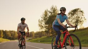Tracking shot of a group of cyclists on country road. Fully released for commercial use.  stock video