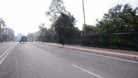 Tracking shot of horse carts moving on the road, Agra, Uttar Pradesh, India stock video