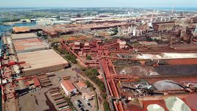 Aerial tracking shot of steel factory stock video footage