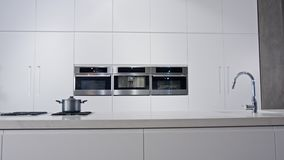 Tracking shot of a luxury kitchen with white modern design