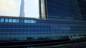 Tracking shot of modern skylines from Dubai Metro, Dubai, United Arab Emirates stock video