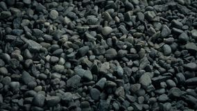 Gravel Surface Moving Shot. Tracking shot moving slowly over gravel stones stock footage