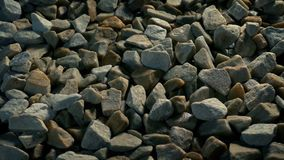 Moving over gravel stones path. Tracking shot moving slowly over gravel stones stock footage