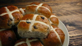 Passing plate of hot cross buns on table stock video footage
