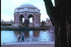 Tracking shot of people  in front of Palace of Fine Arts stock video