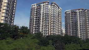 Tracking shot of residential buildings in Singapore - modern housing stock footage