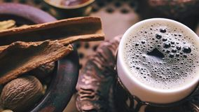 Turkish coffee tracking. Tracking shot of turkish coffee and spices stock video