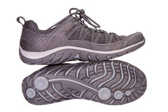 Tracking sporting black sneakers, breathable material, isolated Stock Image