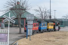 Kid trackless train ride in public winter event in Irving, Texas. Trackless train ride wagon waiting at station in public park winter event in Irving, Texas, USA Stock Photos
