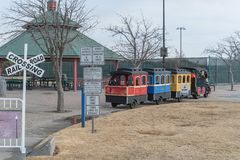 Kid trackless train ride in public winter event in Irving, Texas. Trackless train ride wagon waiting at station in public park winter event in Irving, Texas, USA Stock Images