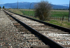 Tracks. Railroad tracks leading into the Idaho countryside Royalty Free Stock Images