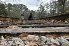 On the tracks. Me, sitting on the tracks stock photography