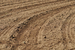 Tracks in bare soil in a field Stock Photo
