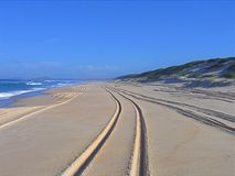 Tracks on a beach. 4WD track on a beach in Australia. Concept of eternity or holiday Stock Photos