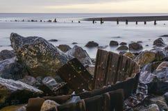 Tracks on the Beach 2. Broken steel tracks help form the Homer Spit causeway Stock Image