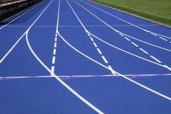 Tracks on blue field Stock Photo