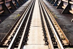 Tracks at close/Rail rode. Rail transport is a means of transferring of passengers and goods on wheeled vehicles running on rails, also known as tracks royalty free stock photo