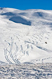 Tracks in creamy snowscape. Creamy snowscape with lots of tracks Royalty Free Stock Photo