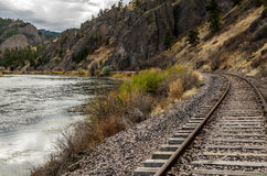 Tracks Curving to Follow the River Stock Photography