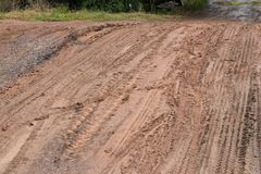 Tracks on a dirt road in the countryside. Royalty Free Stock Photo
