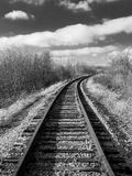 Tracks into Distance. Curved Railroad tracks heading into the distance royalty free stock images