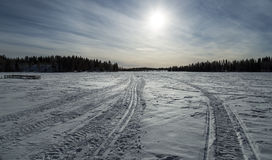 Tracks on Frozen Lake in Winter Stock Photography