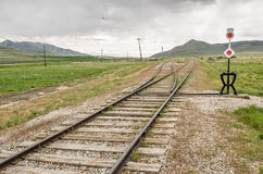 Tracks Heading West. Railroad tracks heading west toward the mountains from Promontory Summit Royalty Free Stock Images