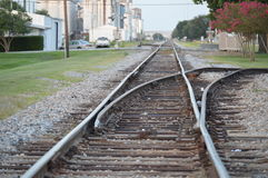 Tracks leading through industrial area Stock Images