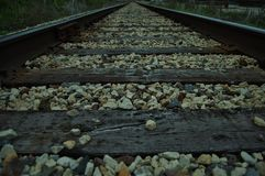 Tracks. A lone Railroad track leading off to unknown destination Royalty Free Stock Photos